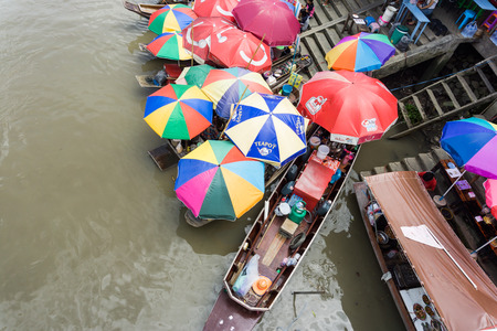 SAMUT SONGKHRAM, THAILAND - JULY 22, 2017 : AMPHAWA FLOATING MARKET is one of the most exciting and colorful places to visit in Thailand today.