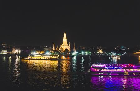 BANGKOK, THAILAND – 5 December 2017: Night View of WAT ARUN (TEMPLE OF DAWN) and Chao Phraya River, Bangkok, Thailand.