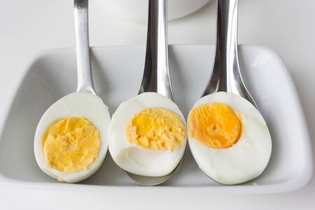 Sliced boiled eggs on spoons, Ready to eat.