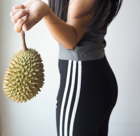 Asian slim woman holding durian, king of fruit in Thailand, Health concept.