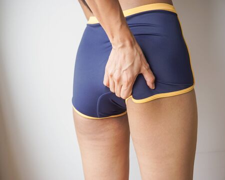 Woman with cellulite, orange peel, Checking cellulite.