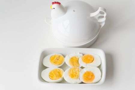Half boiled egg, cut on a plate, Ready to eat. Stock fotó