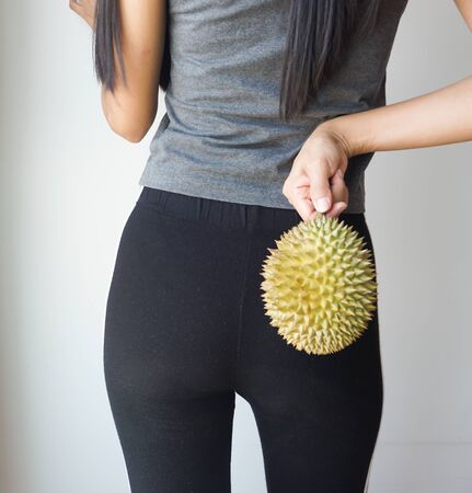 Asian slim woman holding durian, king of fruit in Thailand. Stock Photo