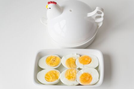 Sliced boiled eggs on white plate, Ready to eat.