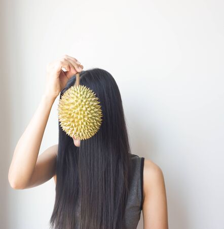 Asian slim woman holding durian, king of fruit in Thailand, delicious. Stock Photo