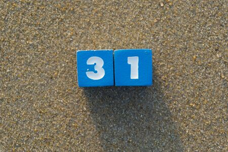 Number thirty one on sand. Stock Photo