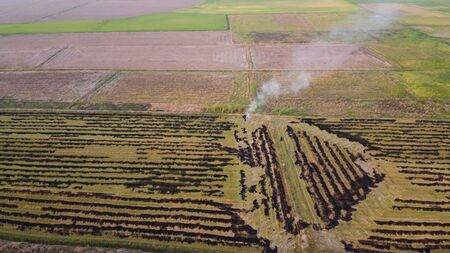Aerial view of the smoke from burning rice fields, Air pollution, Dust problem.