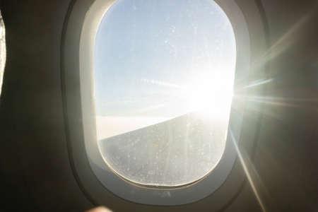 Airplane window with white light, travel by plane. 版權商用圖片