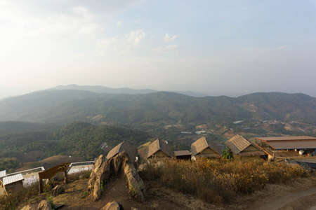 Views of the rooftops, clouds, mist in the sky and mountains in the morning, the sights of northern Thailand.