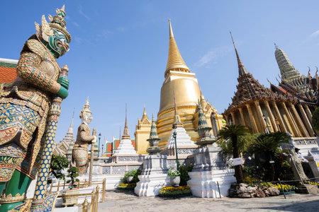 Giant statue at Temple Wat Pra Kaew, famous tourist destination of Bangkok.