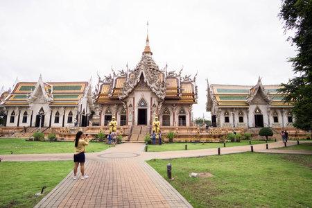 Nakhon Pathom, Thailand-November 1, 2020 : Asian tourists at Wat Si Sa Thong, Amazing old Historical Sites in Thailand.