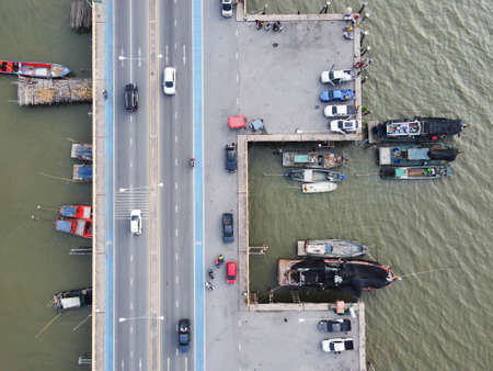 Top view of Cars on bridges and local fishing boats community in Chonburi Province, Thailand.