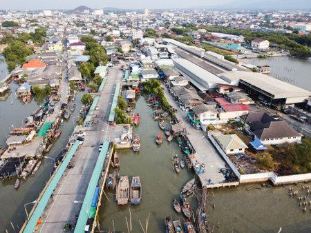 Views of the dense village, and fishing occupation, local fishing boats moored at the bridge, Chon Buri, Thailand.