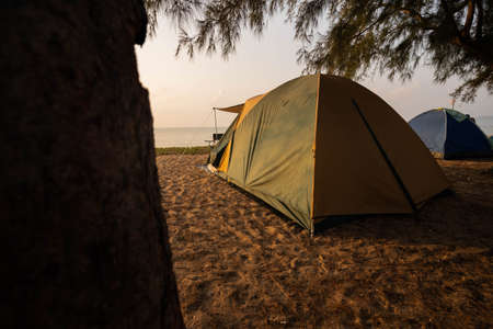 A tourist's tent is at the beach in the morning, time to enjoy nature.