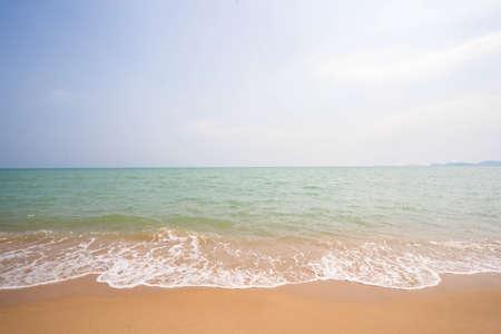 White waves on a beautiful beach, sea and blue sky, sea background.