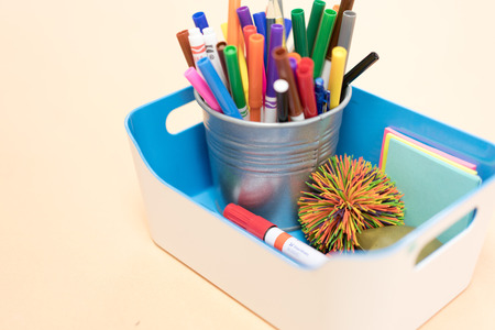 A bucket of colors marker & others