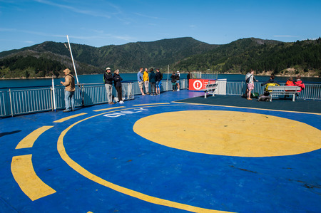 Cook Strait, New Zealand - February 4, 2016: Passengers on ferry traveling from Wellington to Picton via Marlborough Sounds, New Zealand