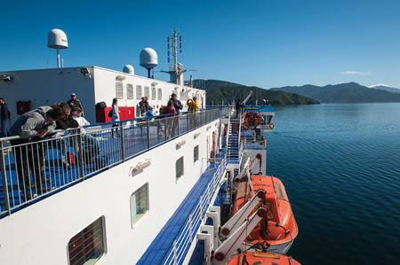 marlborough: Cook Strait, New Zealand - February 4, 2016: Passengers on ferry traveling from Wellington to Picton via Marlborough Sounds, New Zealand
