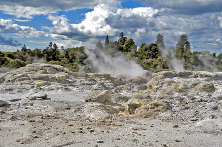 Sulfur from Whakarewarewa Geyser at Te Pui thermal park in geothermal valley of Rotorua, New Zealand Stock Photo