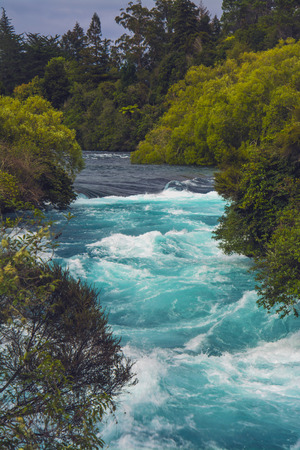 drains: The Huka Falls are a set of waterfalls on the Waikato River that drains Lake Taupo in New Zealand.