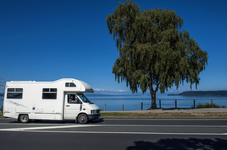 Taupo, New Zealand - March 2 2015: A motorhome driving along the coast of Lake Taupo in North Island of New Zealand