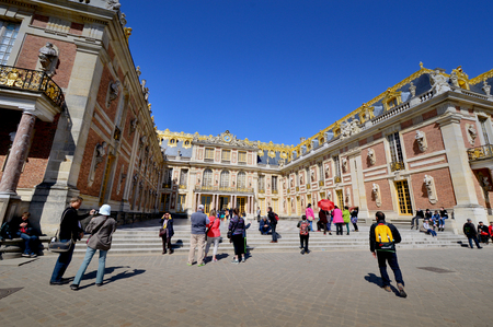 louis the rich heritage: VERSAILLES, FRANCE - April 19, 2015: Tourists visiting Versailles Palace, UNESCO list of World Heritage Sites, in the city of Versailles, France.