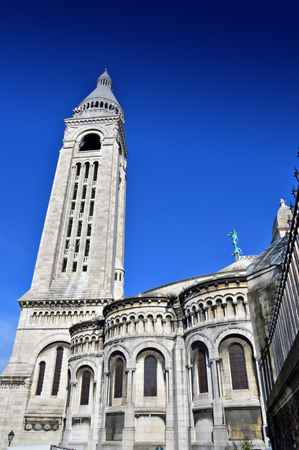 sacre coeur: Paris, France - April 2015: The Basilica of the Sacred Heart of Paris, a Roman Catholic church and minor basilica, located at the summit of the butte Montmartre, the highest point of Paris
