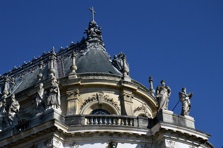 louis the rich heritage: VERSAILLES, FRANCE - April 19, 2015: Ornamented buildings of the Royal Chapel in front of the Palace of Versailles, France Editorial