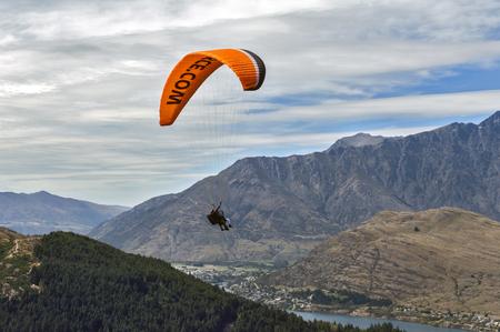 Queenstown, New Zealand - March 2016: Tandem paragliding over Lake Wakatipu in Queenstown, New Zealand