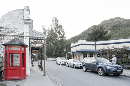 antique booth: Arrowtown, New Zealand - February 2016: Old classic buildings and shops on Buckingham Street in the historic town of Arrowtown Editorial