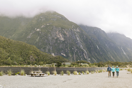 milford: Milford Sound, New Zealand - February 2016: Tourists at Milford Sound passenger terminal pier