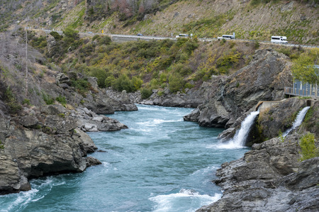 hydro electric power station: The Roaring Meg (Te Wai a Korokio) the turbulent stream that both drives this hydro electric power station and merges with the Kawarau River, Central Otago, south island of New Zealand