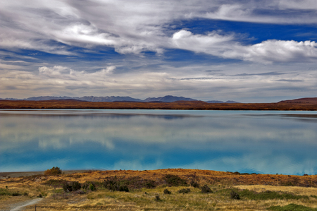 hooker: Lake Pukaki fed by the Tasman River, which has its source in the Tasman and Hooker Glaciers, close to Aoraki  Mount Cook in South Island of New Zealand