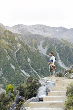 national scenic trail: A man enjpying scenic view along the walking trail to the Blue Lakes and Tasman Glacier View, Aoraki  Mount Cook National Park Stock Photo
