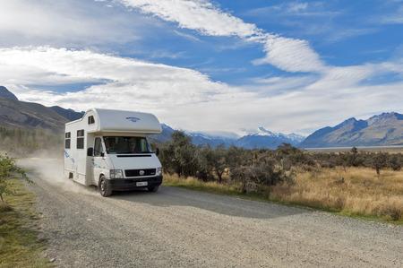 Canterbury, New Zealand - February 2016: Motorhome driving on gravel road at Glentanner Park Centre, Aoraki / Mount Cook National Park Editorial