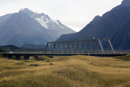hooker: Truss bridge over Hooker River on Tasman Valley Road leading to Tasman Lake in Aoraki Mount Cook National Park, New Zealand Stock Photo