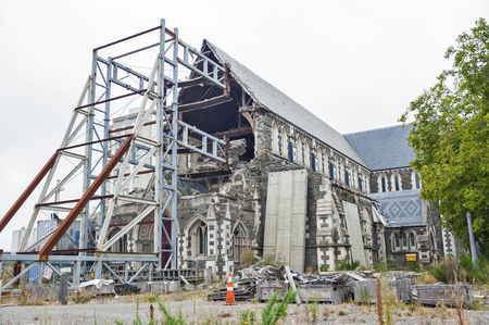 earthquake crack: Christchurch, New Zealand - February 2016: Badly damaged Christchurch Cathedral by the 2011 earthquake at the Cathedral Square in Christchurch Central Editorial