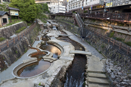 Kobe, Japan - March 2016: Hot spring stream flowing pass town centre of Arima Onsen in Kita-ku, Kobe, Japan.