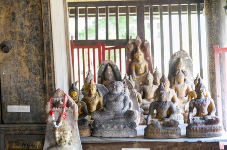 Yasothon, Thailand - May 2017: Buddha images inside Ho Trai or the library of Buddhist scriptures (Tripitaka or Pali Canon) located at Wat Mahathat Temple