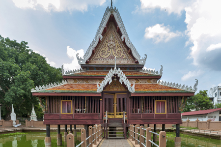 Yasothon, Thailand - May 2017: Ho Trai - Traditional Thai-style building used as a library that houses Buddhist scriptures (Tripitaka or Pali Canon) located at Wat Mahathat Temple