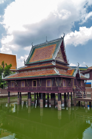 Ho Trai - Traditional Thai-style building used as a library that houses Buddhist scriptures (Tripitaka or Pali Canon) located at Wat Mahathat Temple in downtown Yasothon, northeastern (Isan) province of Thailand