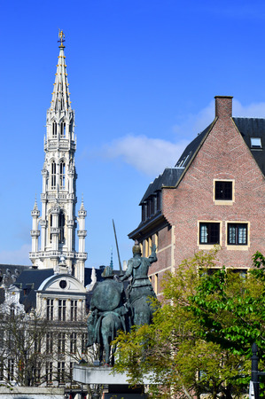 The Brabantine Gothic belfry tower of City of Brussels Town Hall at Grand Place seen from Spanish Square in Brussels, Belgium