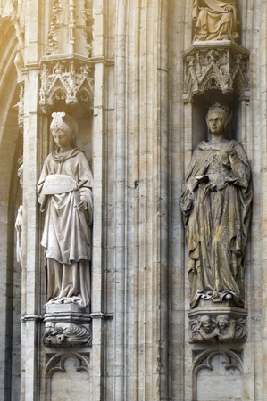 The facade of the Town Hall of the City of Brussels, a building of gothic architectural style from the middle ages decorated with numerous statues representing nobles, saints, and allegorical figures, located at the Grand Place in Brussels, Belgium Stock Photo