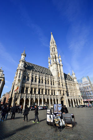 Brussels, Belgium - April 2015: Tourists visiting the Town Hall of the City of Brussels, a building of gothic architectural style from the middle ages located at the Grand Place in Brussels, Belgium