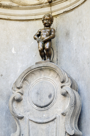 Manneken Pis or Little Man Pee, a landmark small bronze sculpture designed by Hiëronymus Duquesnoy the Elder, located near Grand Place in the city of Brussels, Belgium