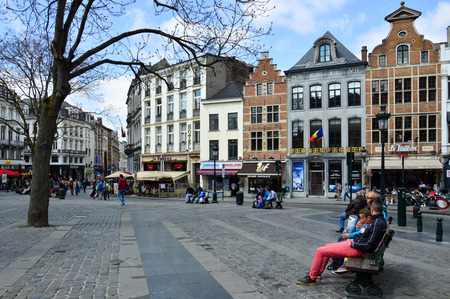 Brussels, Belgium - April 2015: Touristic area of Grass Market (Grasmarkt) at Agora Square surrounded by preserved historic buildings from the 17th-18th century, near the famous Grand Place in city center of Brussels, Belgium Editorial