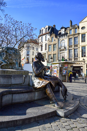 Brussels, Belgium - April 2015: Bronze statue of Charles Buls or Karel Buls, a Belgian politician and mayor of the City of Brussels during 1881-1899, located at Grass Market, Agora Square near Grand Place in Brussels, Belgium Editorial