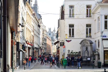 Brussels, Belgium - April 2015: Group of tourists visiting Manneken Pis or Little Man Pee, a landmark small bronze sculpture designed by Hiëronymus Duquesnoy the Elder, located near Grand Place in the city of Brussels, Belgium Editorial