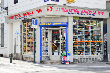 Brussels, Belgium - April 2015: Local grocery selling food, tobacco, and alcoholic drinks in Brussels, Belgium