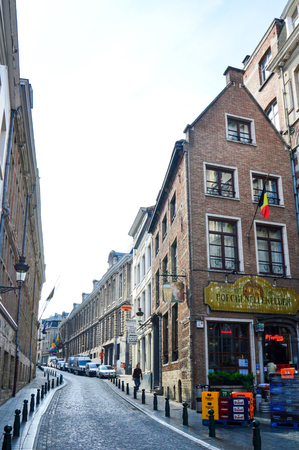 Brussels, Belgium - April 2015: Preserved old European-style residential and commercial buildings on streets of Brussels City, Belgium Editorial